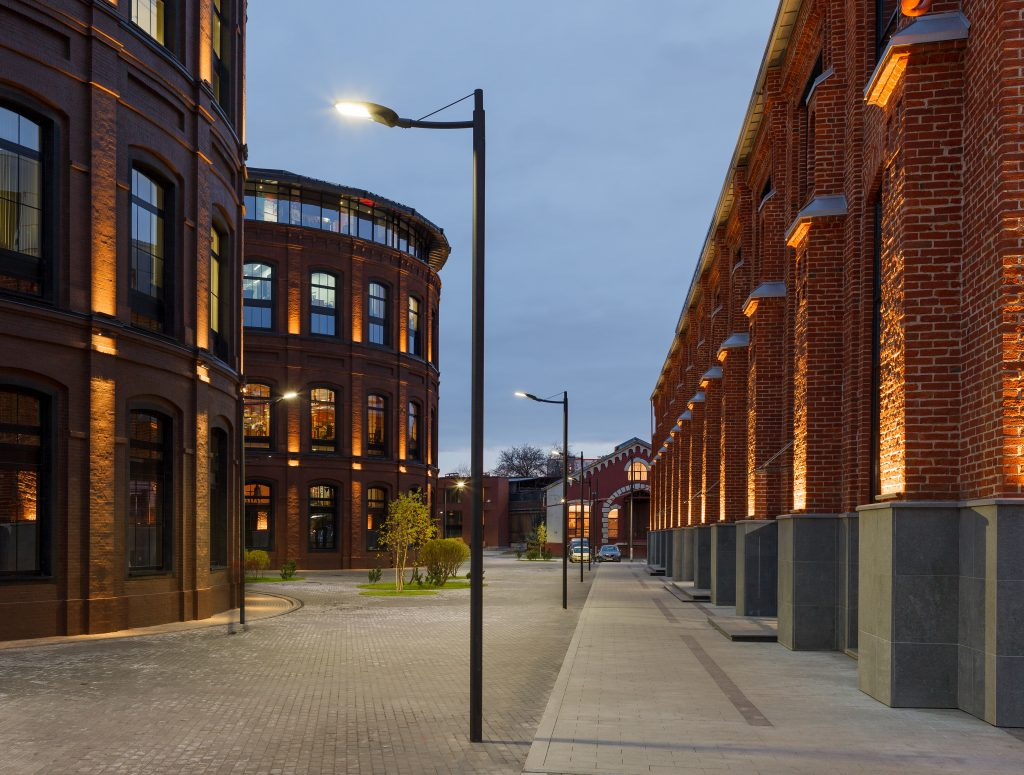 Office complex exterior in loft style. Street lamps and Evening illumination